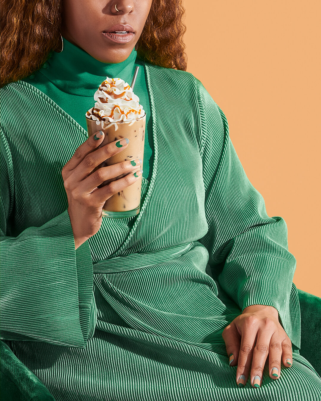 credits: photo- jenna gang, food styling- jen beauchesne, clothing- ross mcCallum, nail design- Ada Yeung, nail tech- michelle sun  description: conceptual still life of model drinking iced frappicino.