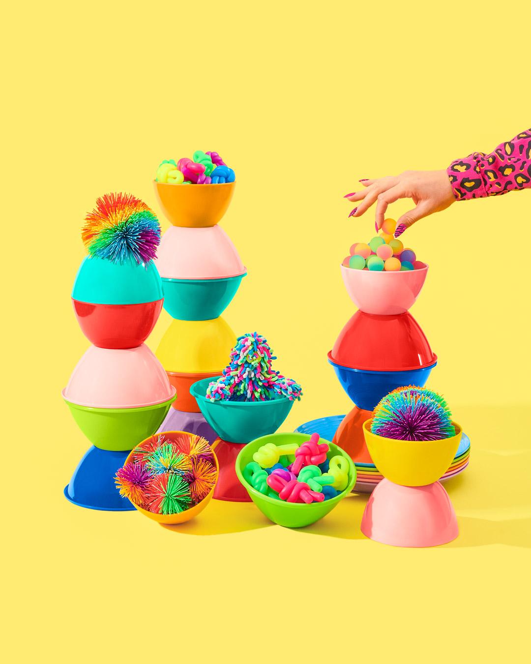 credits: photo - jenna gang, styling - chelsea volpe, nails - natsume chiharu, model - pauline sherrow  description: model grabbing for colorful ball.