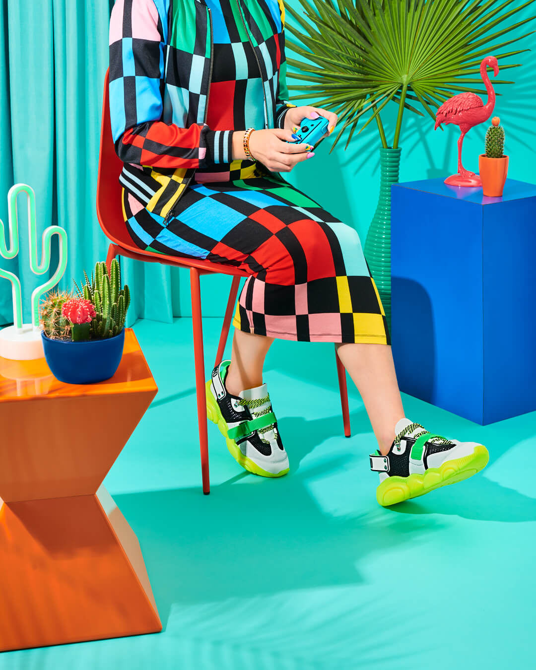 credits: photo - jenna gang, styling - chelsea volpe, nails - natsume chiharu, model - pauline sherrow  description: model playing with game wearing moschino, alice & oliva, kate spade, and amazon.