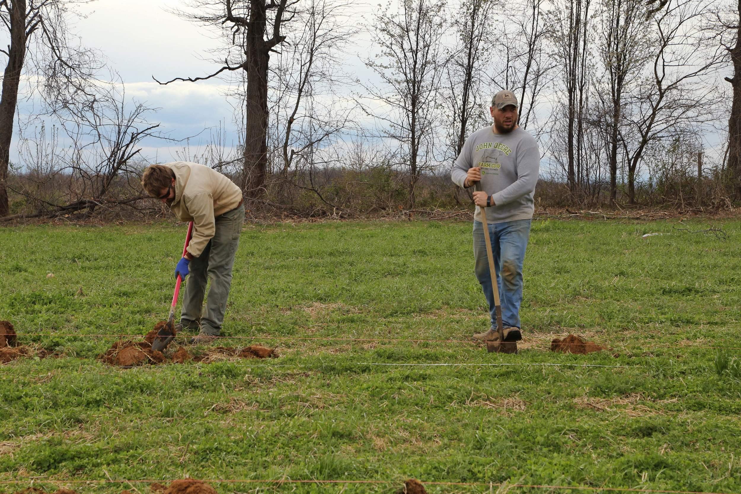 Garrett and I digging holes for planting