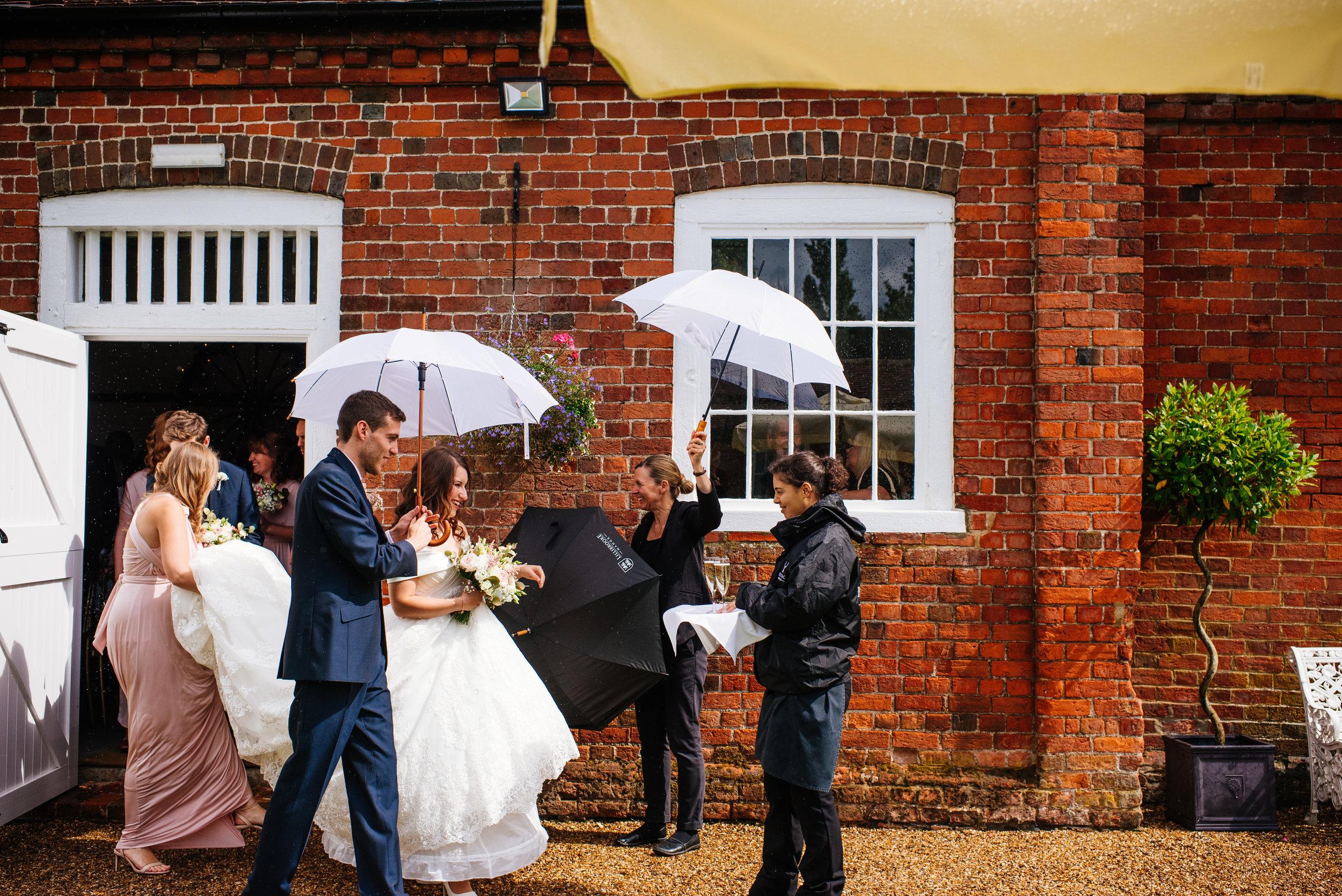 21 Lillibrooke Manor Berkshire Bride Groom Umbrella Wedding Photography.jpg
