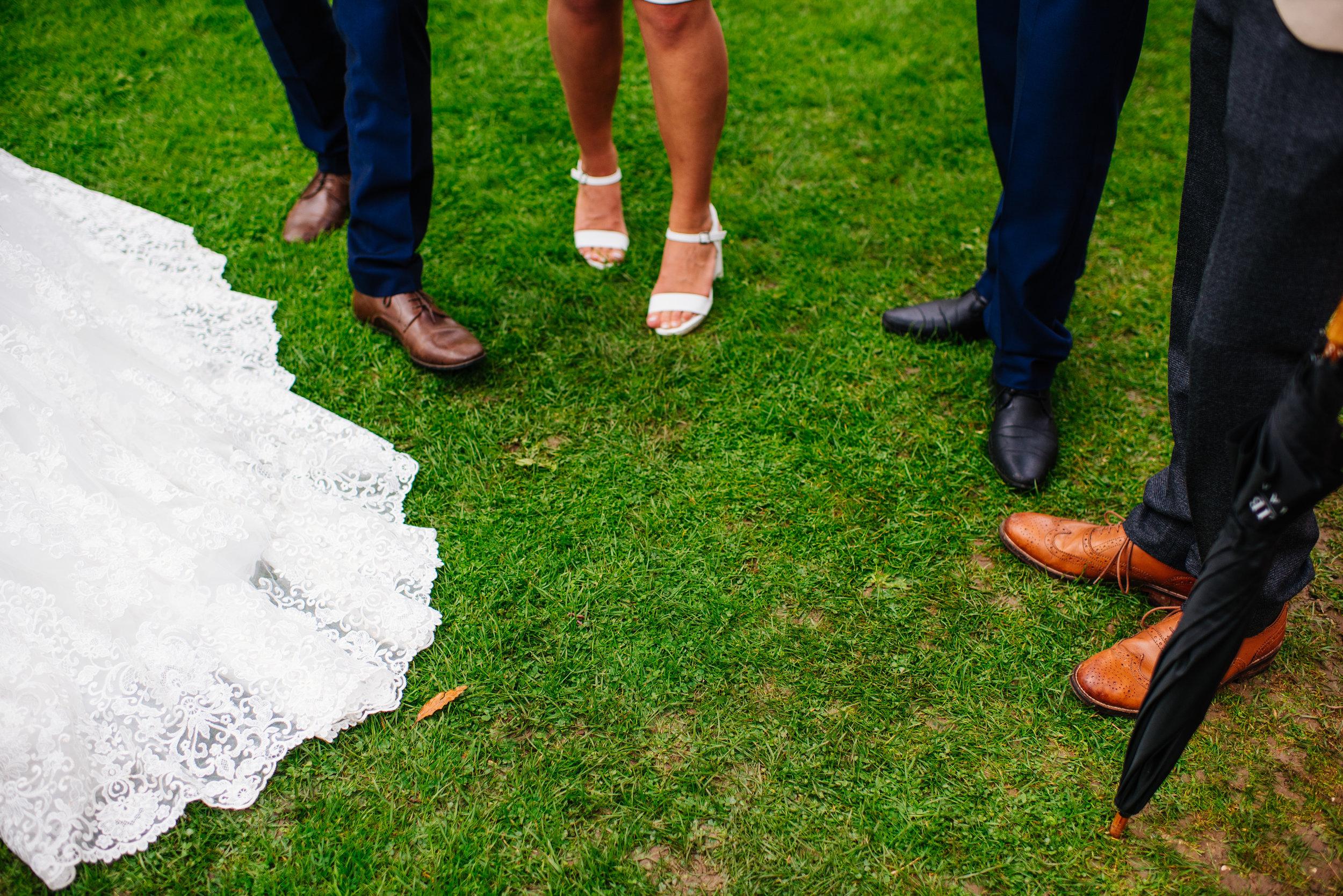 22 Lillibrooke Manor Berkshire Shoes Dress Grass Wedding Photography.jpg