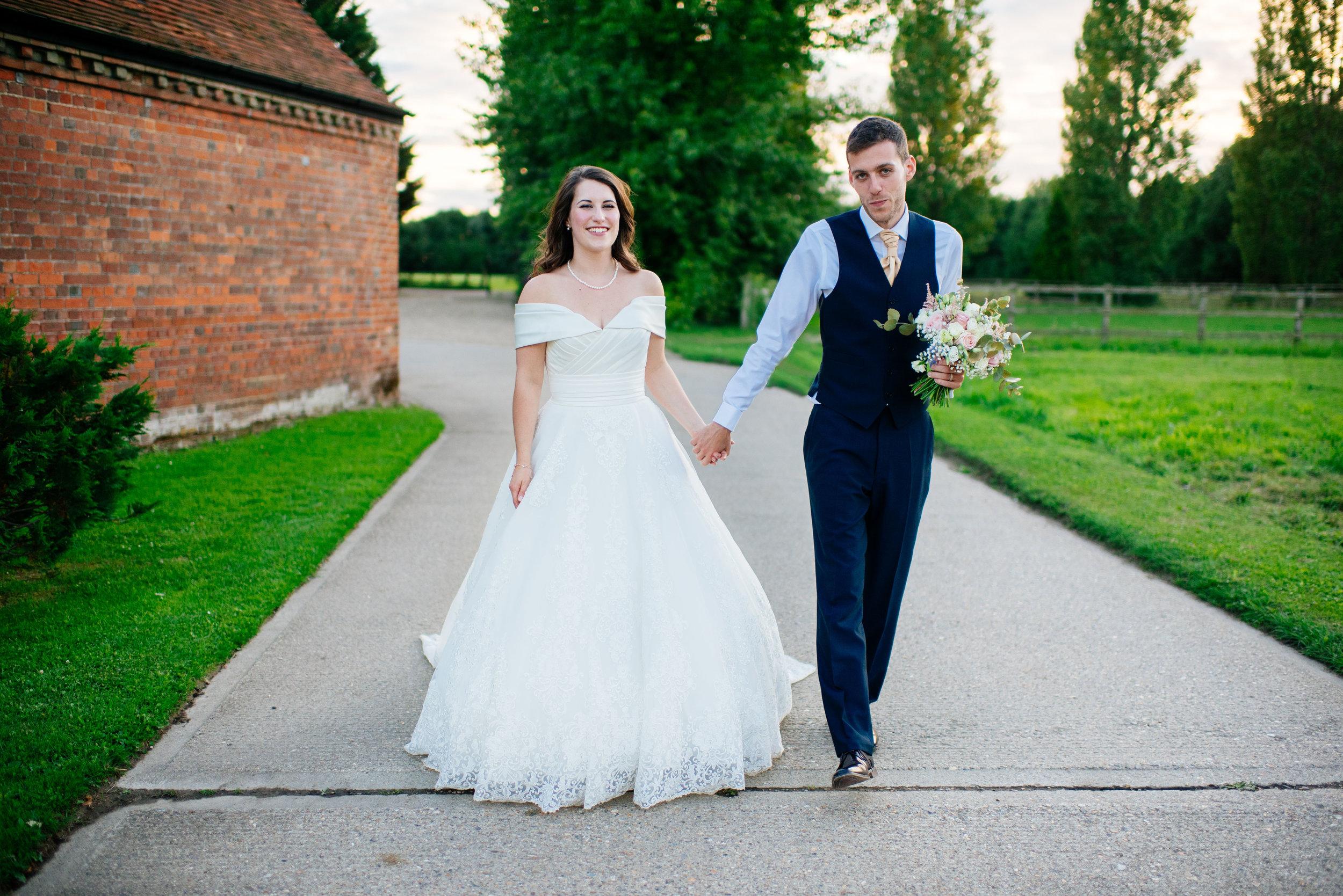 32 Lillibrooke Manor Berkshire Boy Girl Walking Wedding Photography.jpg