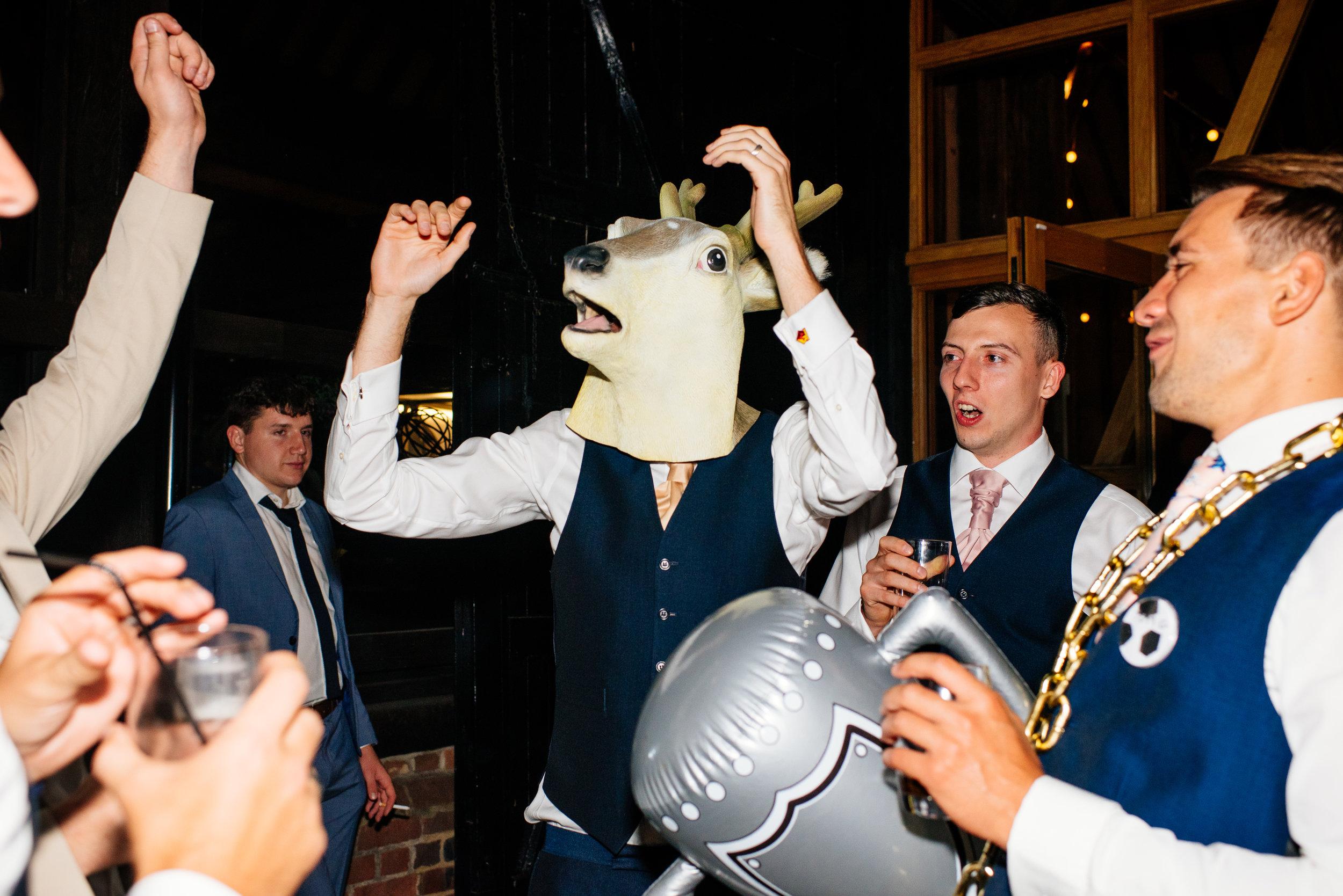 41 Lillibrooke Manor Berkshire Groom Dancing Animal Head Wedding Photography.jpg