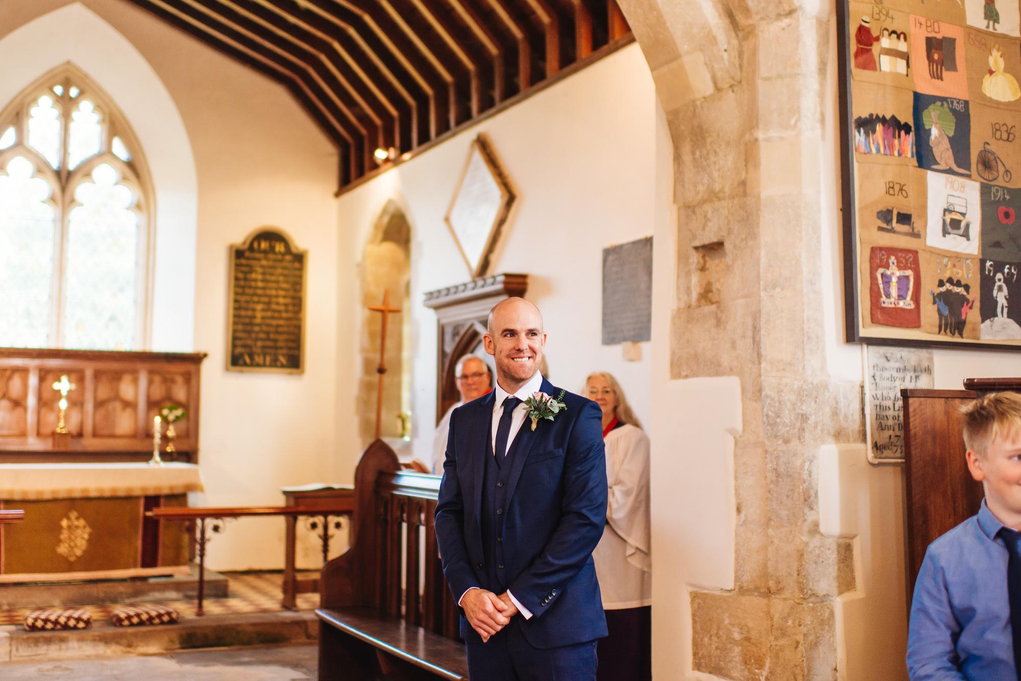 04_Rushall_manor_wiltshire_wedding_photography_groom_church.jpg