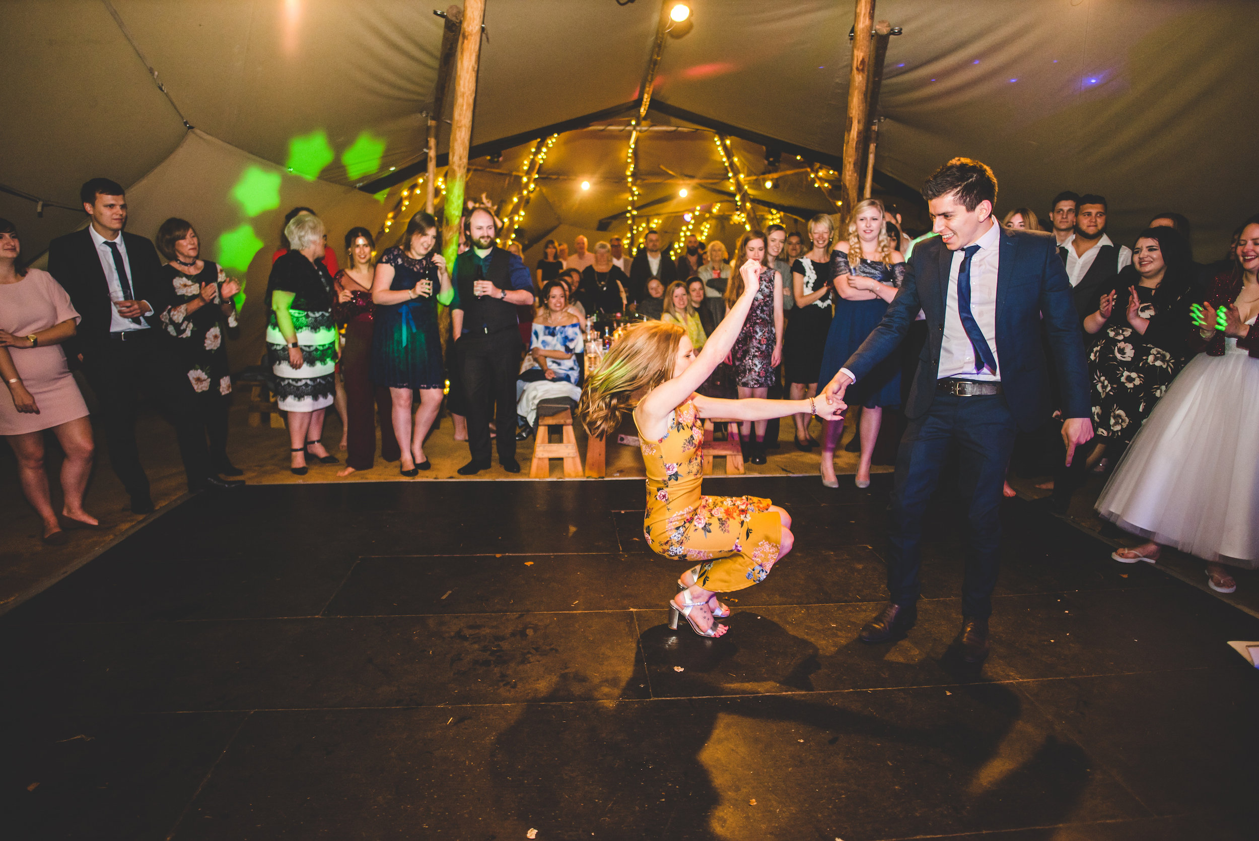 18 Tackeroo Caravan Site Woodland Weddings Staffordshire St John's House Guest Having a Dance Off.jpg