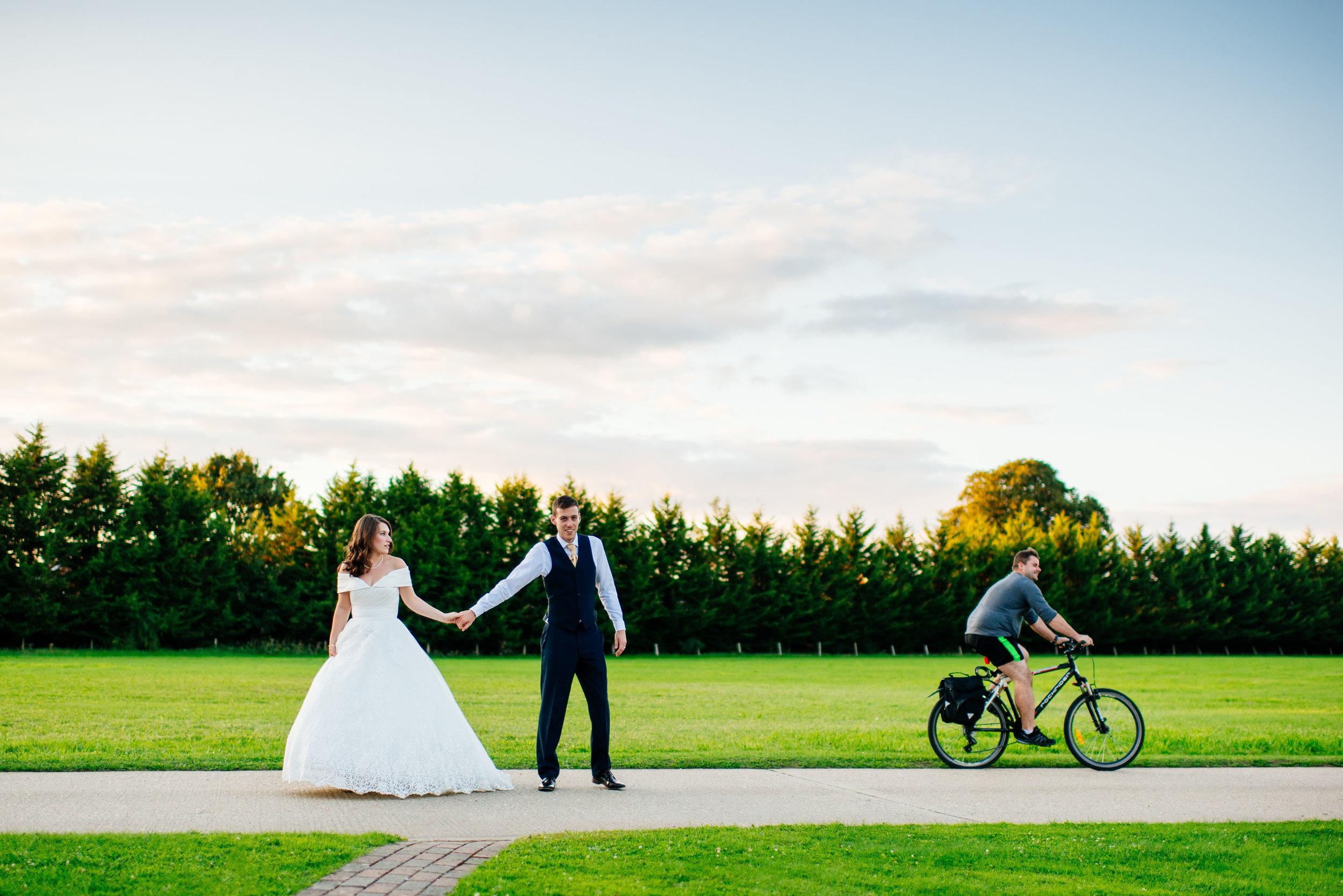 20 Lillibrooke Manor Berkshire Wedding Photography Bride Grrom Cyslists.jpg