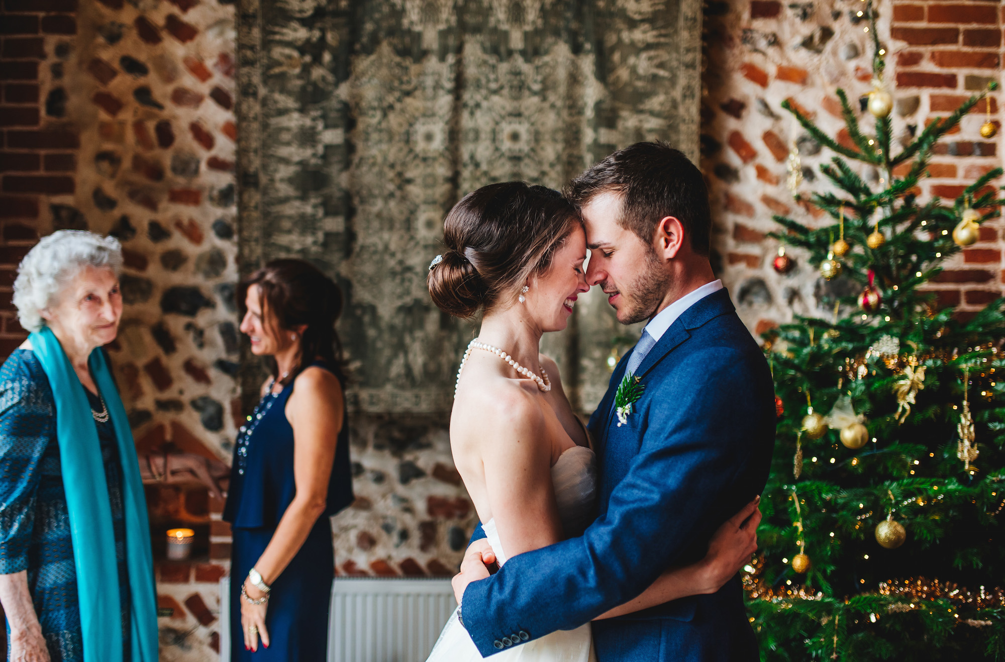 08 Chaucer Barn Norfolk Wedding Photographer Bride Groom Just Married Family Touching Moment.jpg
