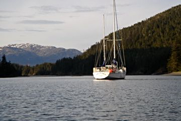 A kayak-level view of Arcturus at anchor in a Southeast Alaska cove.