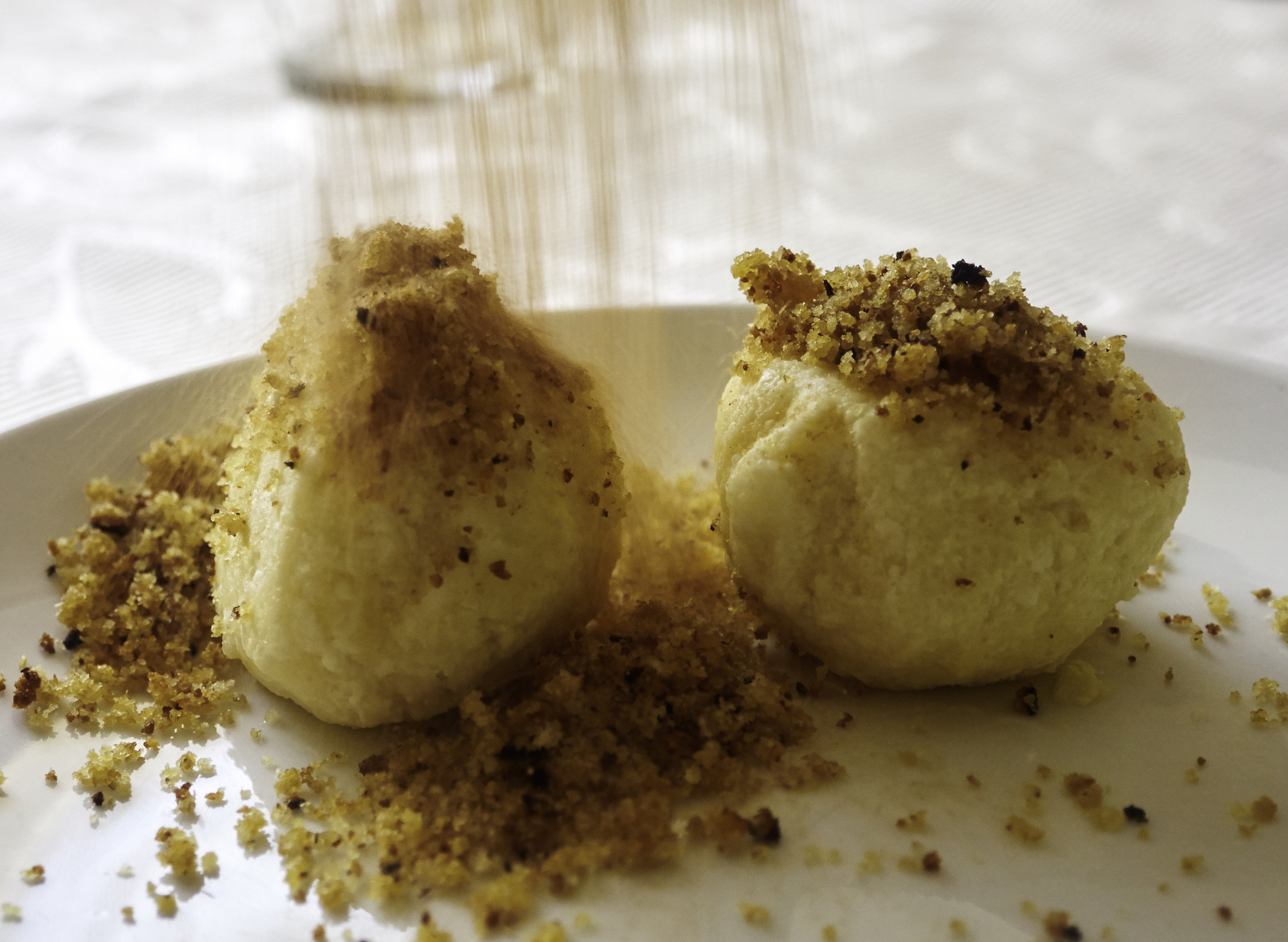 Ricotta dumplings with fried breadcrumbs, cinnamon and sugar.