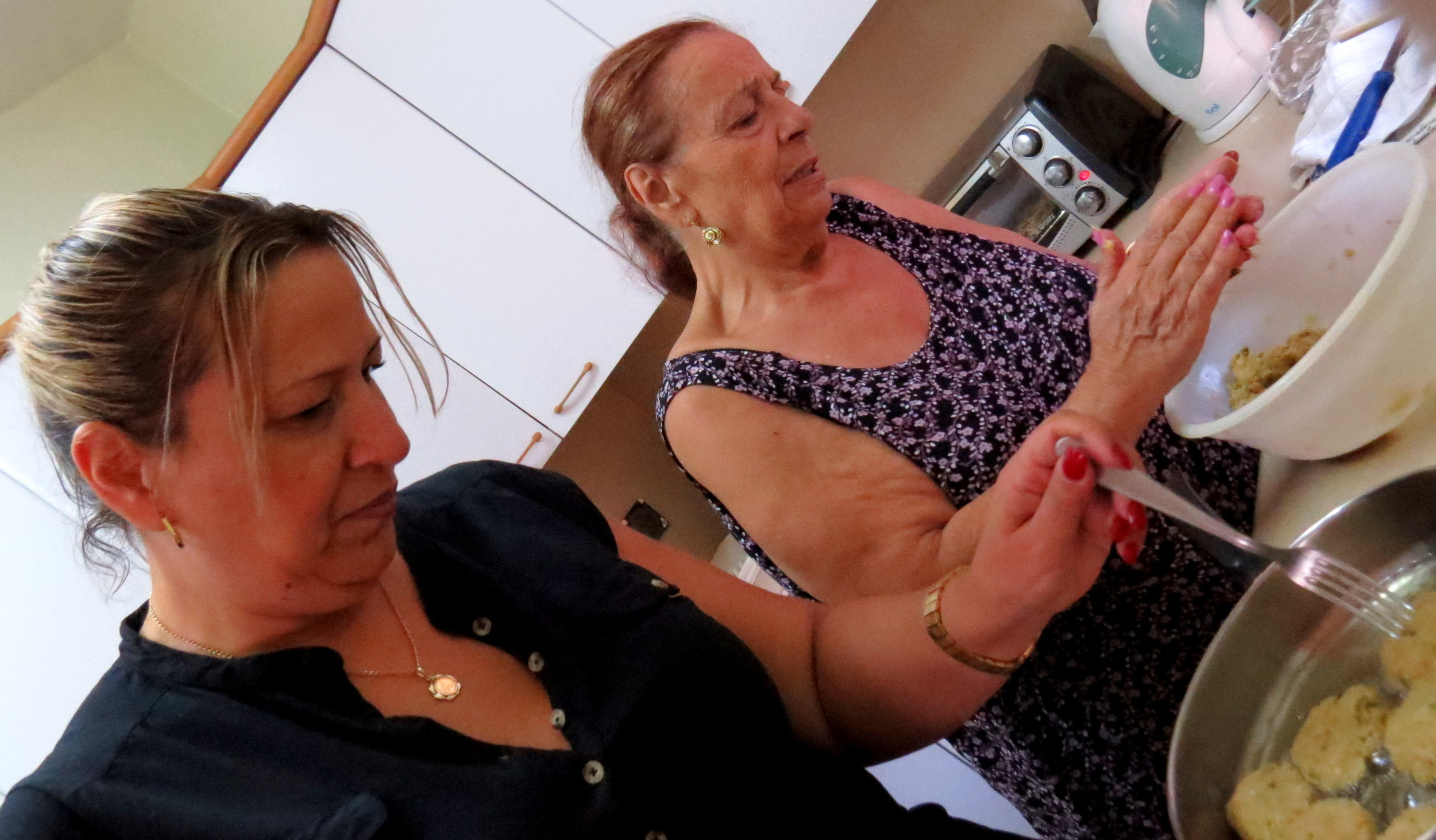 Rosa Bagdadli making leek fritters with her daughter Iris
