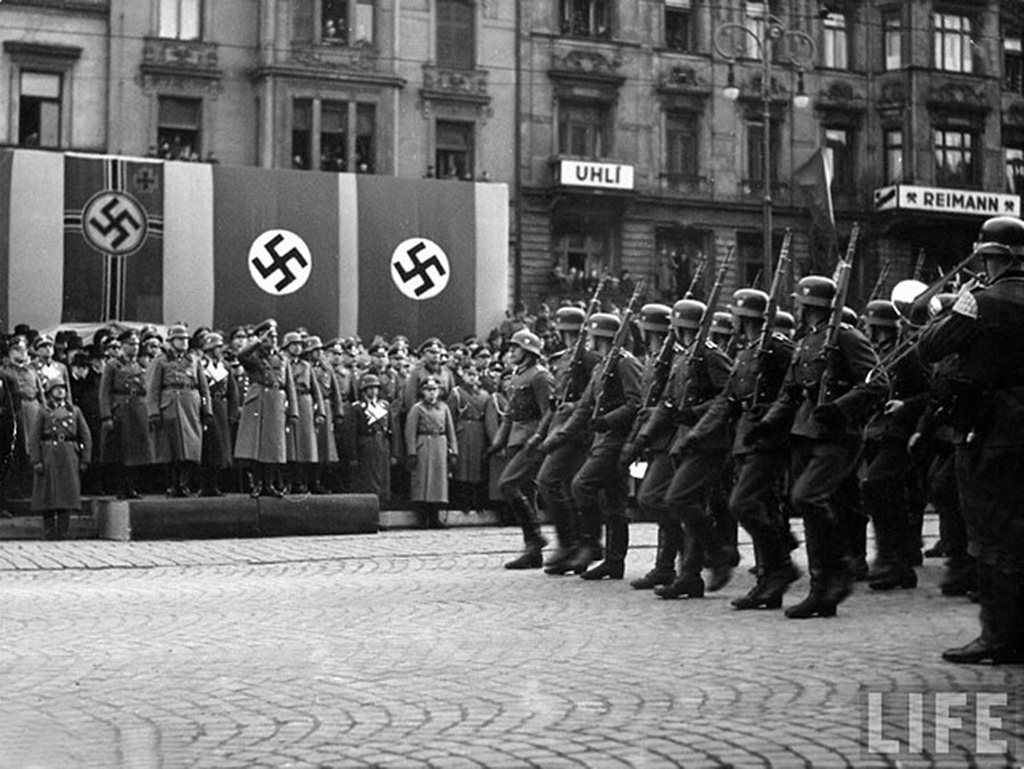 Hitler arrives in Prague in March 1939, the day Germany completes its occupation of Czechoslovakia