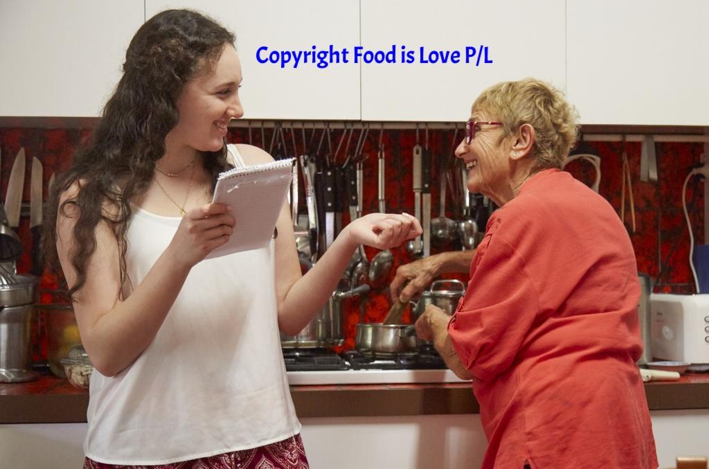 Aviva checks a recipe with her grandmother, Judy Kolt