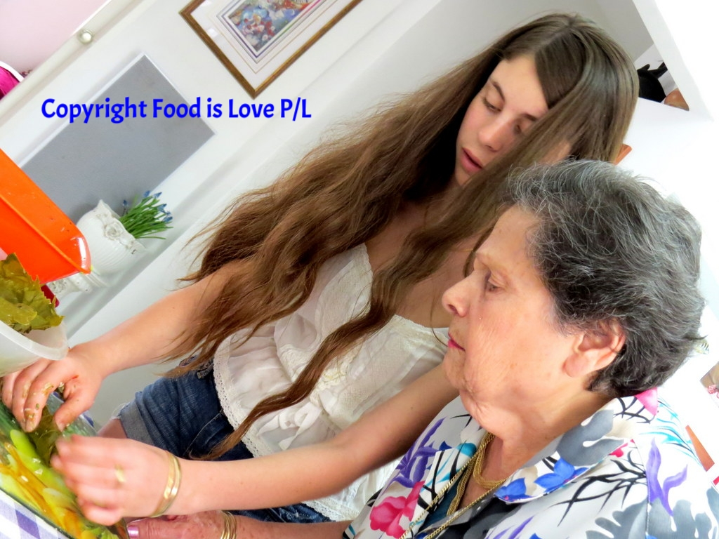 Intense concentration as Jerusalem grandmother Rina Mevorach prepares vine-leaves with her grand-daughter Enelle Mevorach. No mistakes allowed!