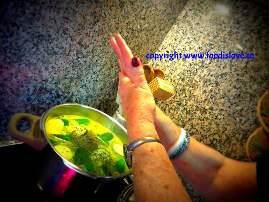 Viviane crumbles dried mint into the soup .