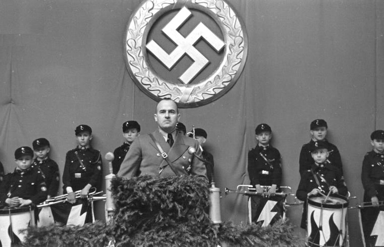 Above:Chief Nazi administrator in Poland, Hans Frank,addresses a Hitler Youth meeting in Tomaszow. Below: Left, Nazi leaders visit Tomaszow; Right,Jews of Tomaszow are rounded up. In 1941, 1500 Jews were deported to surrounding towns. In 1942, around 15,000 Jews they were deported to to the death camp of Treblinka