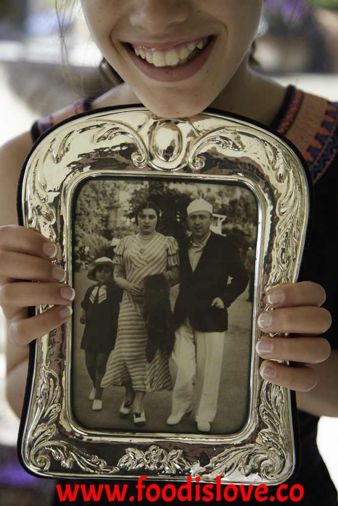 Grand-daughter Taya holds a picture of Celina aged 5, with her parents Joseph and Genia Wald on holiday in 1936. The only family photos which Ruth and Celina have are those their parents had sent to relatives overseas. All their own family photos were destroyed during the War.