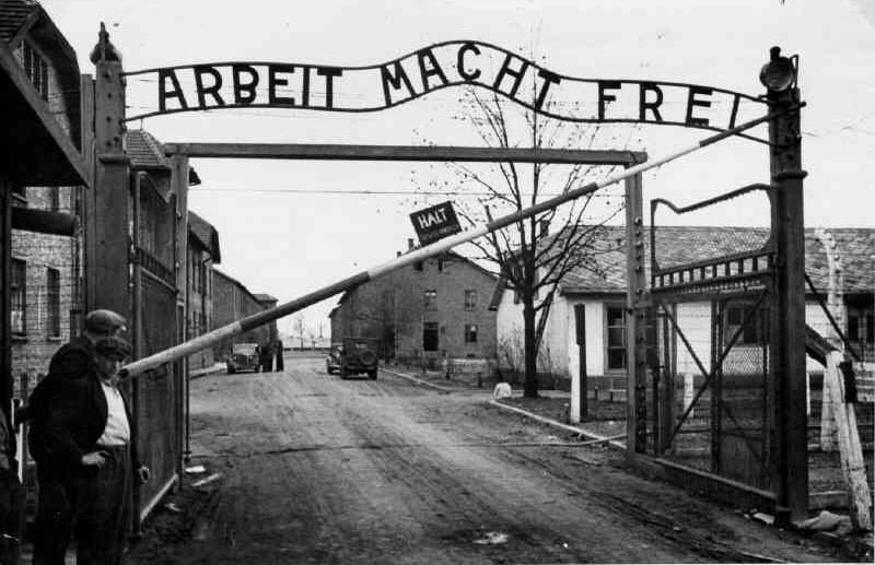 The famous words above the gates at Auschwitz. 'Arbeit macht frei - Work will make you free'. For more than a million people here, it was a cruel hoax. They were all murdered. The only thing that set them 'free' was death. But a small number of young fit people who arrived late in the war, like Tooby, were saved by being taken away from Auschwitz to work as slave labourers.