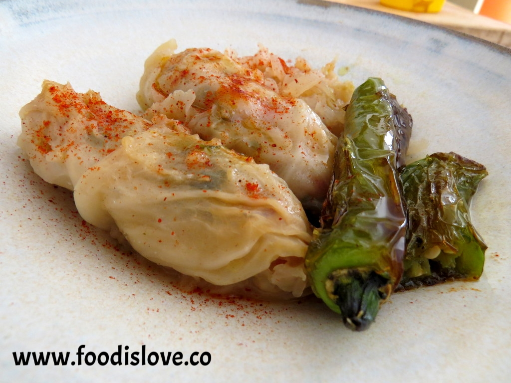 Vegan cabbage rolls served with seared jalapeno peppers and smoked paprika.