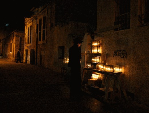 In the Ultra-Orthodox suburbs of Jerusalem, the Hannukah candles are often lit outside in the streets, and glow in the night.