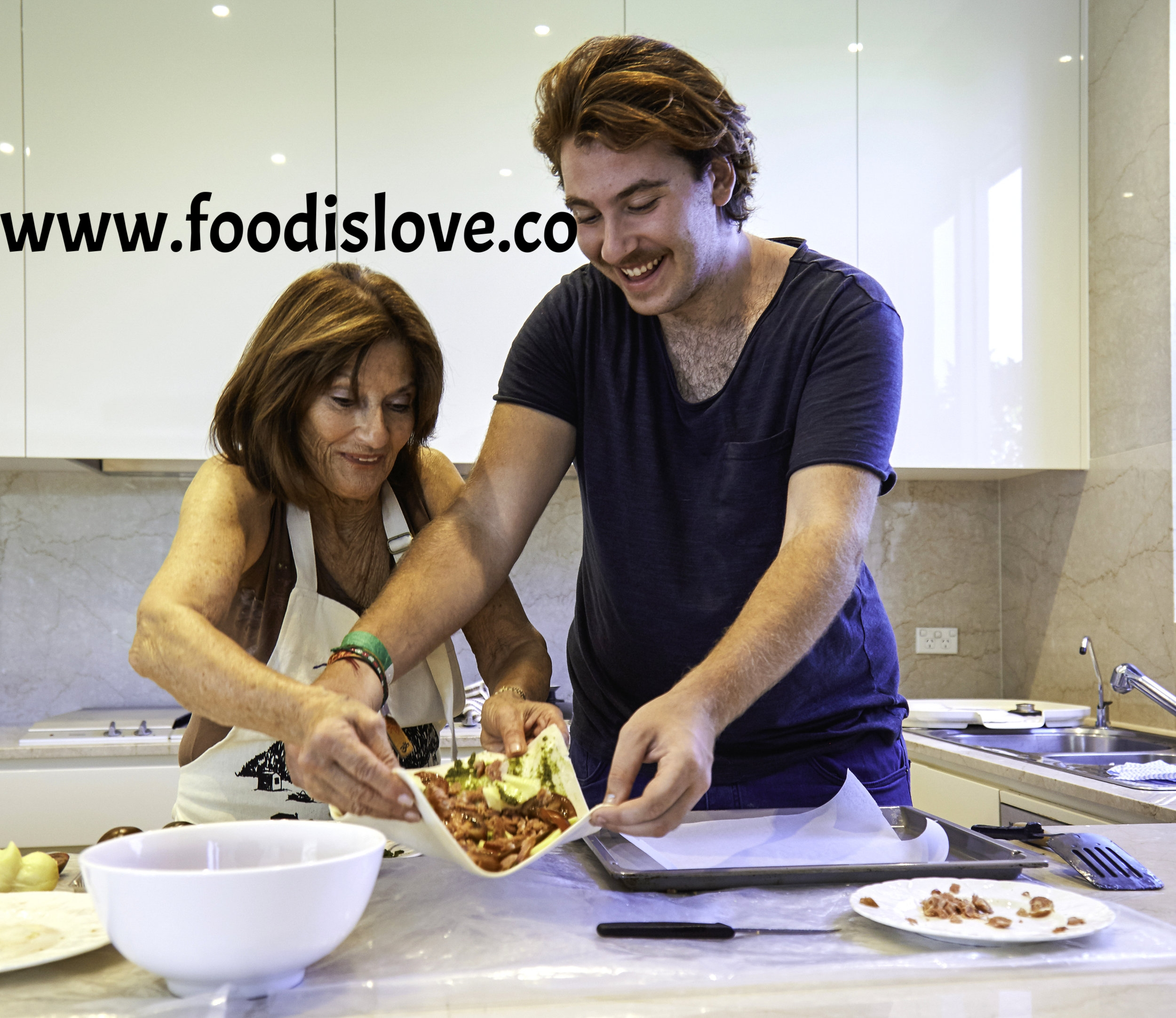 Rita Ross, cooking with her grandson, Jake Glanc