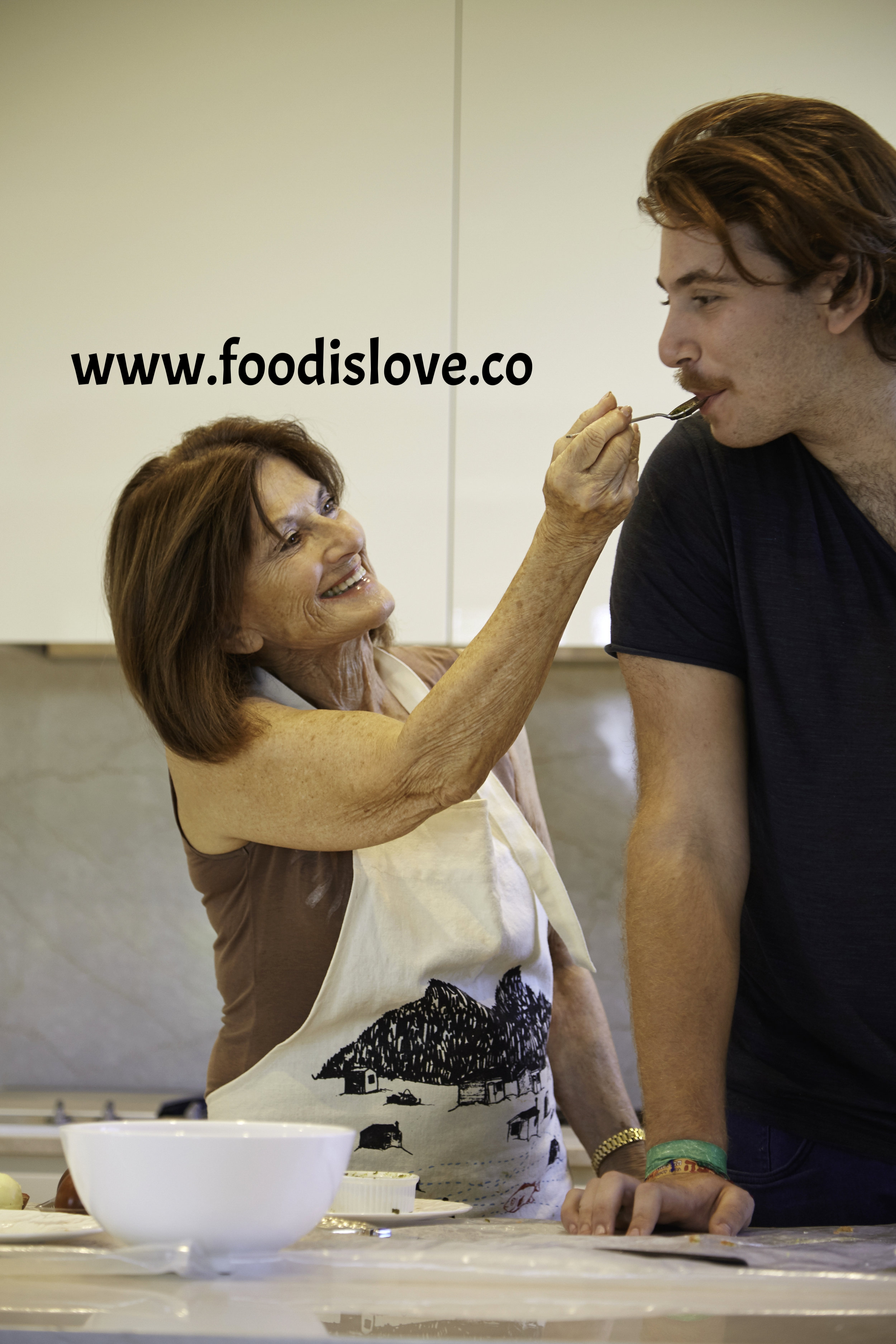 Never too old to taste grandma's cooking straight from the spoon... R\ita Ross with Jake Glanc
