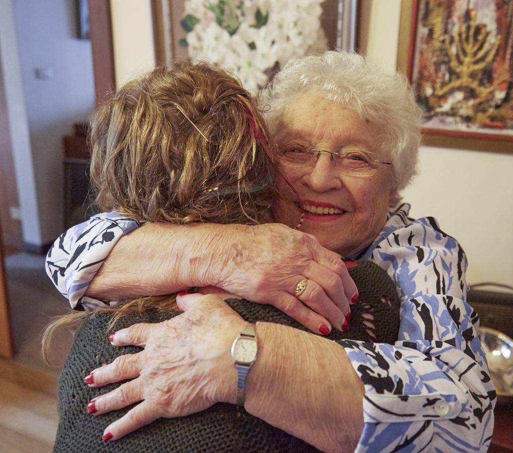 Saba Feniger and her eldest grand-daughter, Keren Dobia. Hugging always improves baking results...
