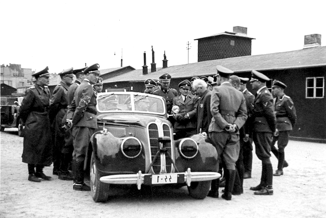 Chaim Rumkovski, controversial Jewish leader of the Lodz Ghetto, meeting with Nazi officials, including SS Chief Heinrich Himmler (seated in car) Lodz, 5 Jun 1941