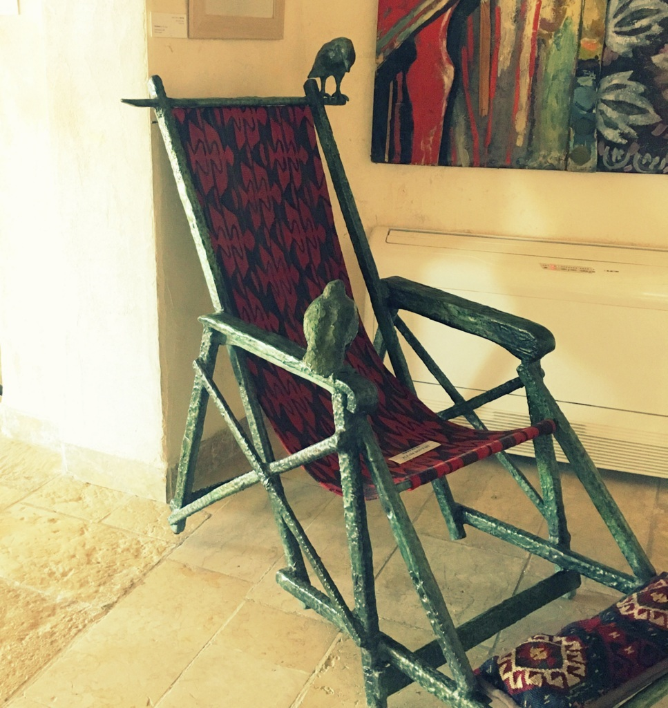 Chair by Ilana Goor. I like the crows. Two came to visit on our balcony each day.