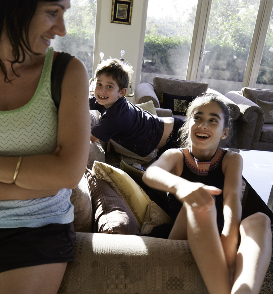 Ned and Taya,   two of Celina's six grandchildren, with their mother, Celina's daughter.