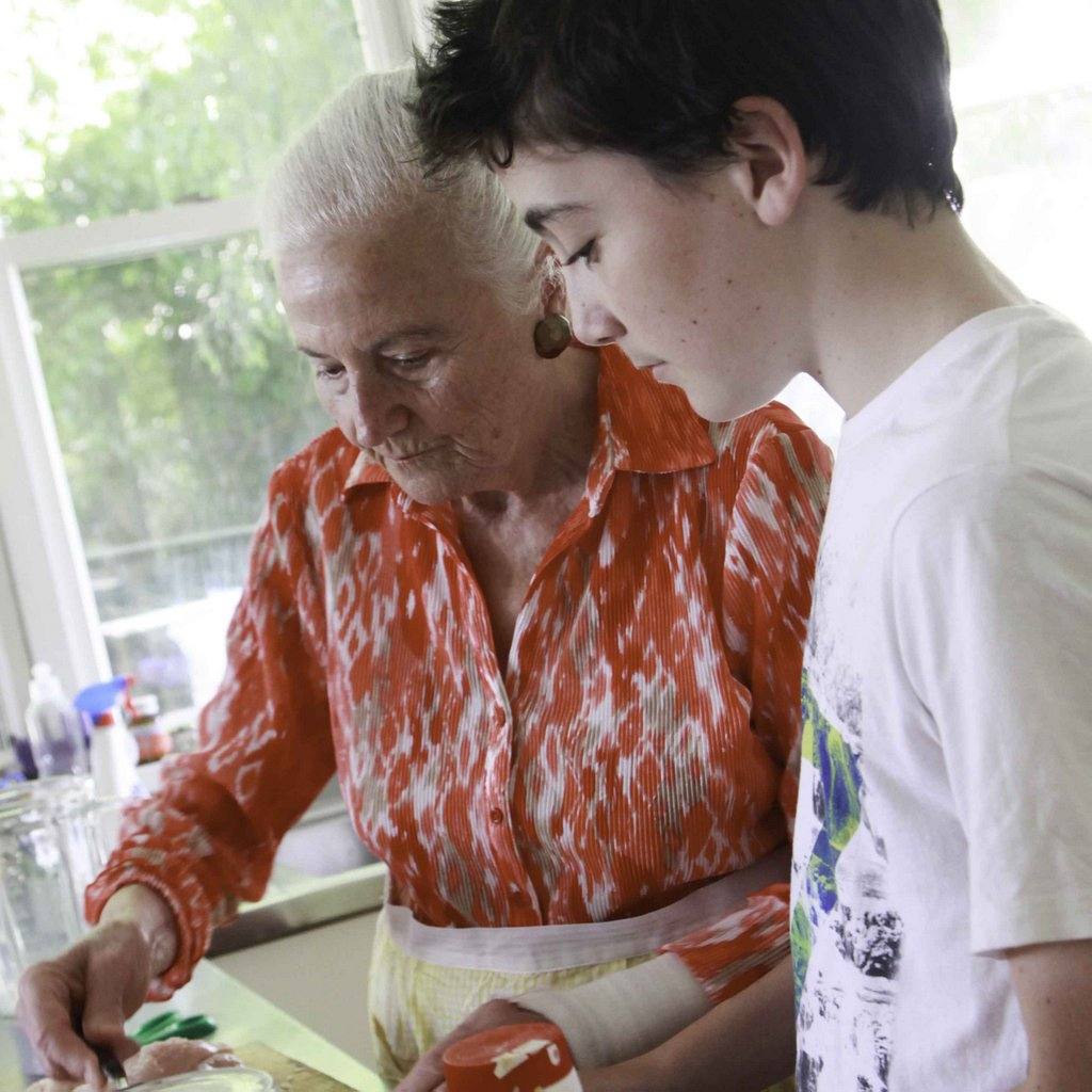 Eva cooks with her grandson Nicholas Rice.
