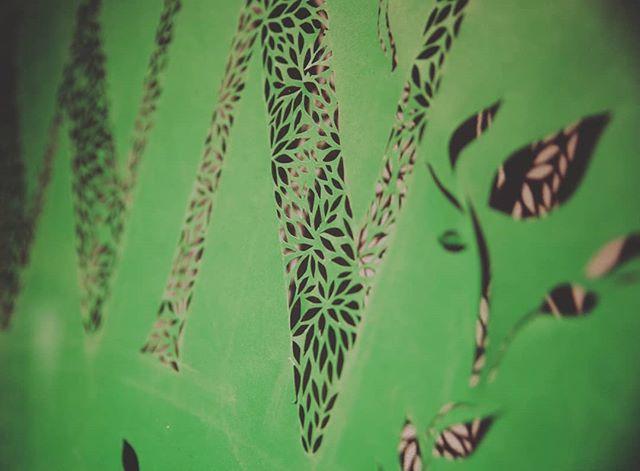 Close up on my papercut piece, on display at @presenttensefitness #rootdownriseup #handlettered #papercut #botanical
