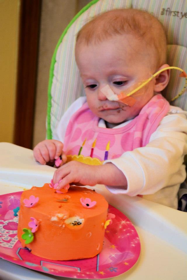 Enjoying her own personal cake!