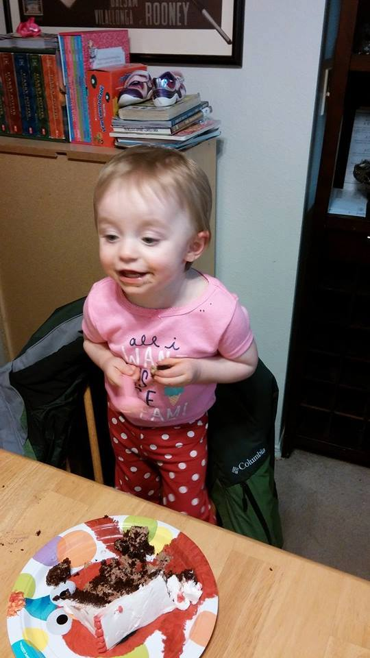Emily enjoying her chocolate cake! What an incredible little fighter!