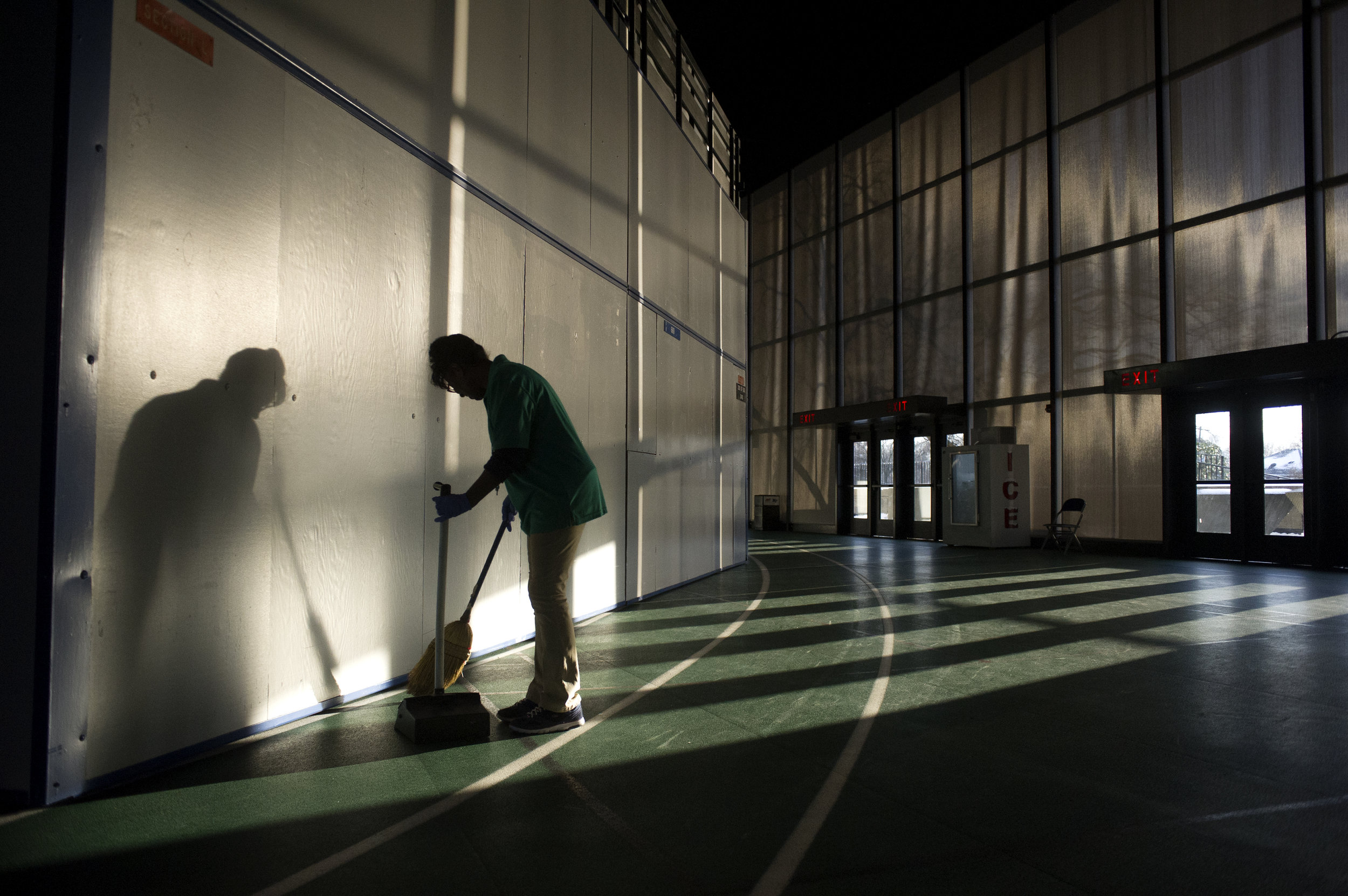 Jan Williams of Murfreesboro sweeps the floors of the Murphy Center in Murfreesboro Thursday, Mar. 5, 2015.
