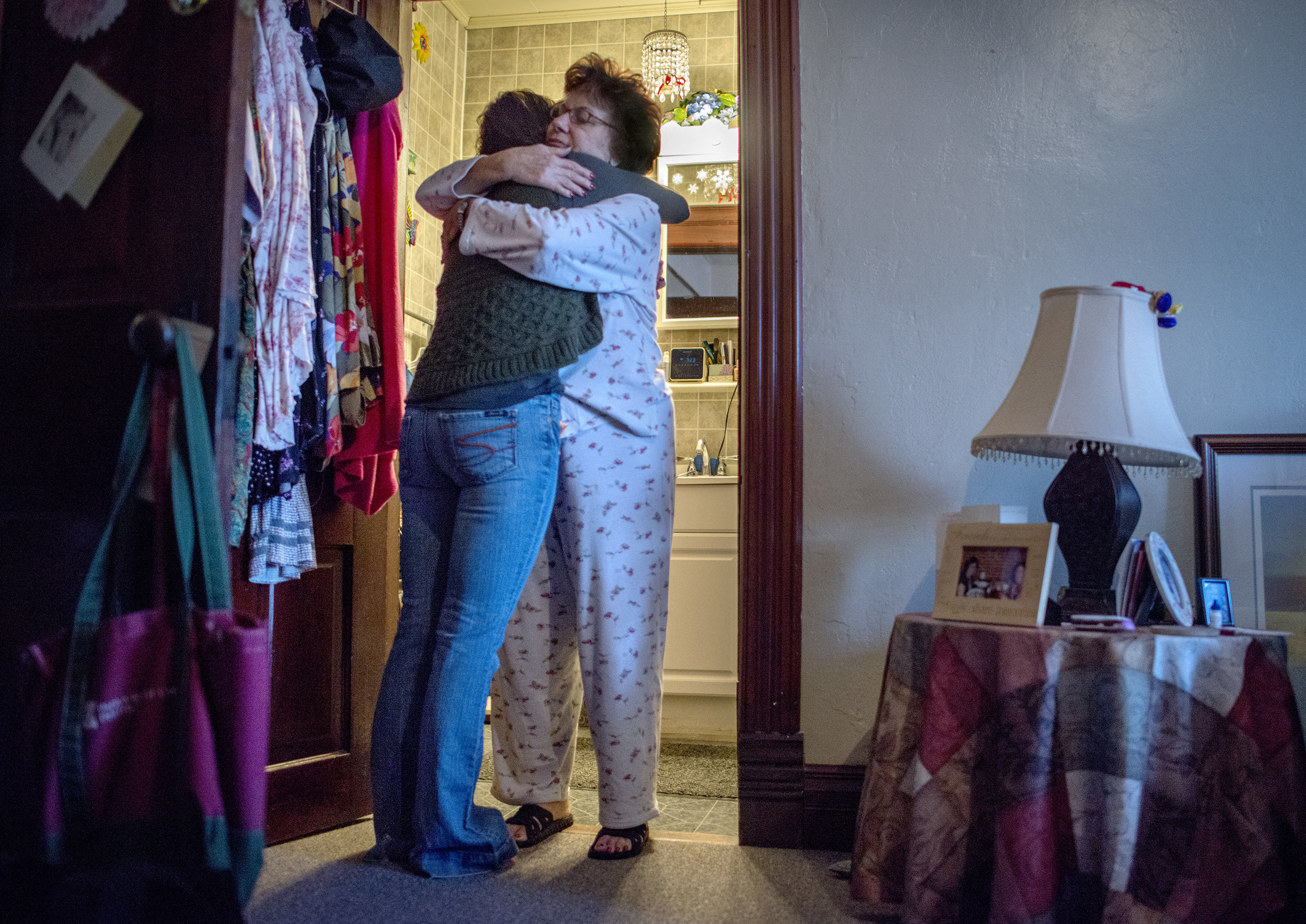 Gayle comforts Kellie before she goes to see her husband at Menard Correctional Center.