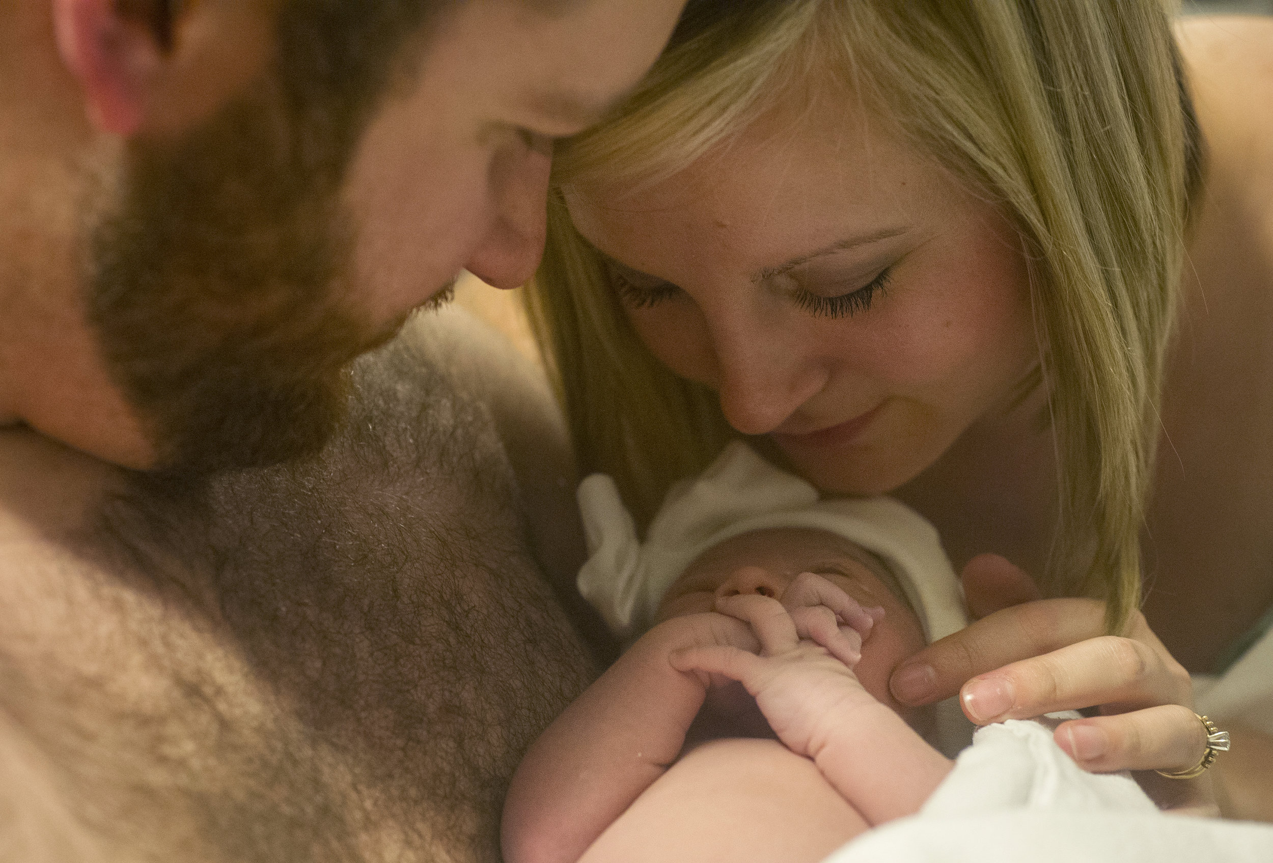 Michael and Erickia hold their daughter skin-to-skin together for the first time after she is born at St. Mary's Medical Center in Evansville Monday Dec. 1, 2014.