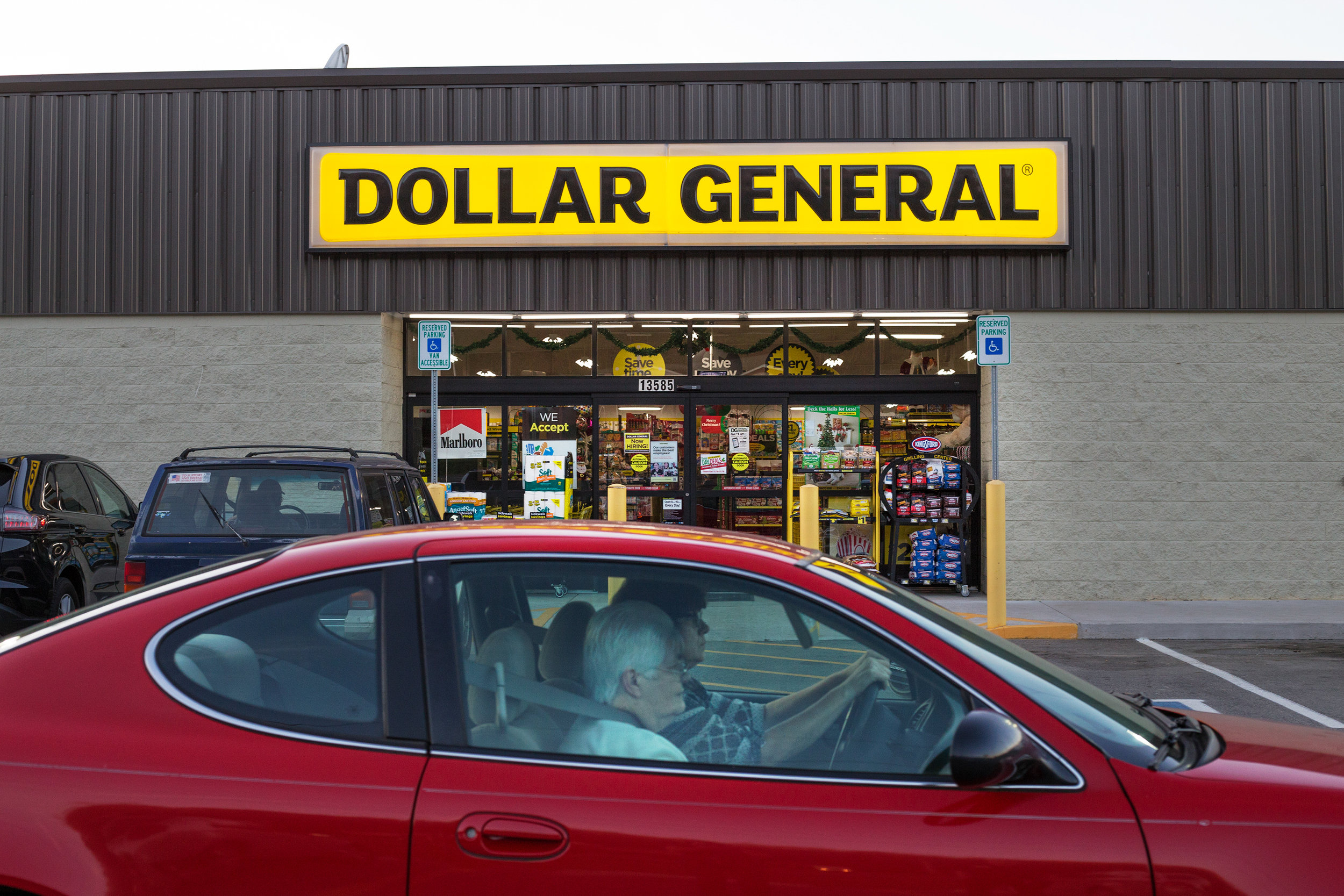 Customers exit the parking lot at the Dollar General in Evensville, Tenn. Thursday, Nov. 16 2017. Dollar General has been opening stores in rural areas, particularly food deserts where residents usually within five miles will go to shop for their groceries. However the chain does not carry fresh fruits, vegetables or meats, leaving the communities they serves to choose from various processed foods.