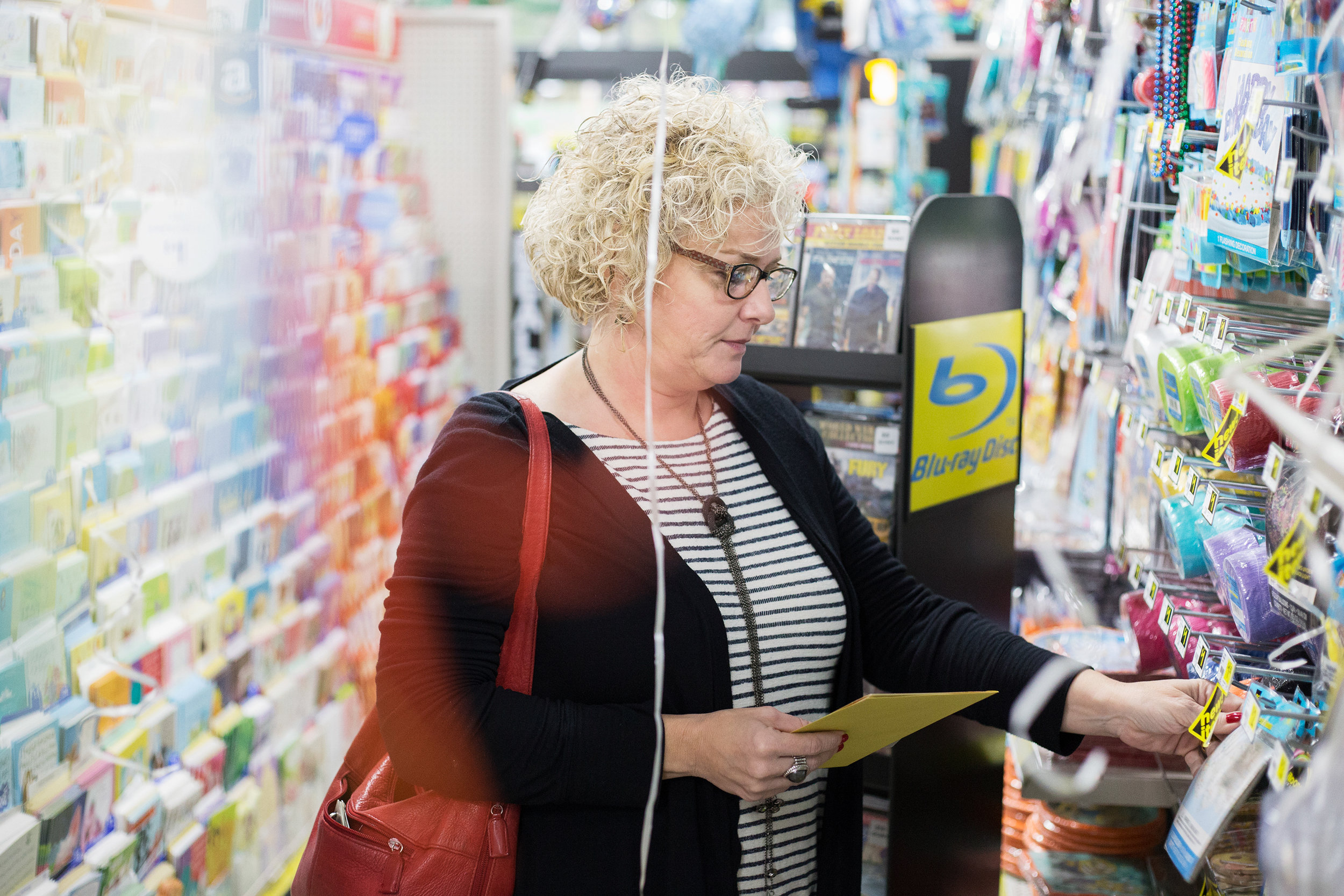 Denise Marler of Evensville, Tenn. shops for a birthday card for her father's 70th birthday at Dollar General in Evensville, Tenn. Thursday, Nov. 16 2017. Marler said she shops at the store two to three times a week.