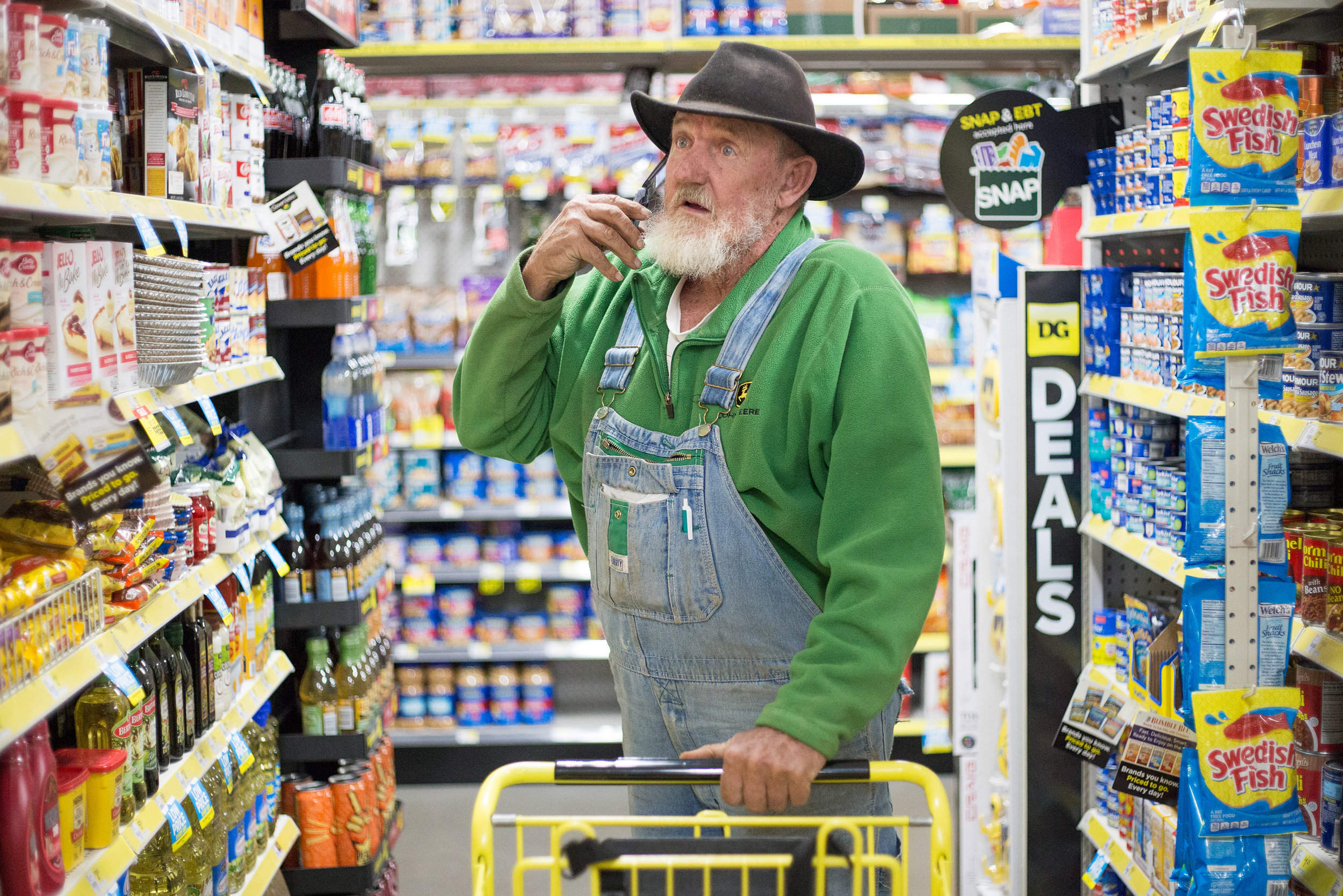 George Beaty of Evensville, Tenn. scans the aisles for cream of chicken soup for his neighbor at Dollar General in Evensville, Tenn. Thursday, Nov. 16 2017. Beaty, a retired welder and plumber, said he usually stops by the store several times a week to pick up whatever he needs.