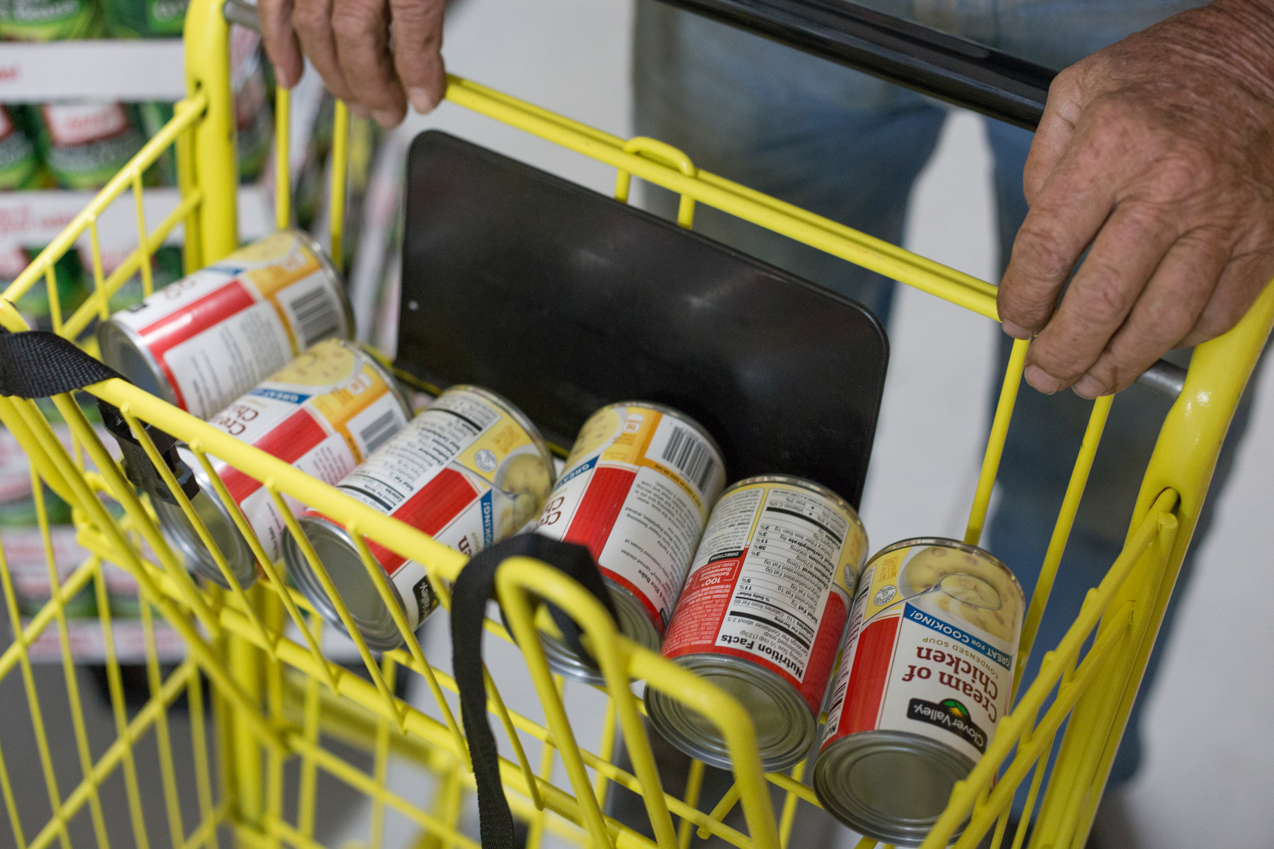 George Beaty of Evensville, Tenn. fills his shopping cart with cream of chicken soup for his neighbor who was not feeling well at Dollar General in Evensville, Tenn. Thursday, Nov. 16 2017. Store manager Justin Ray said that although the store does not carry fresh produce, it is an important grocery source for the people in the surrounding community due to the lack of options.