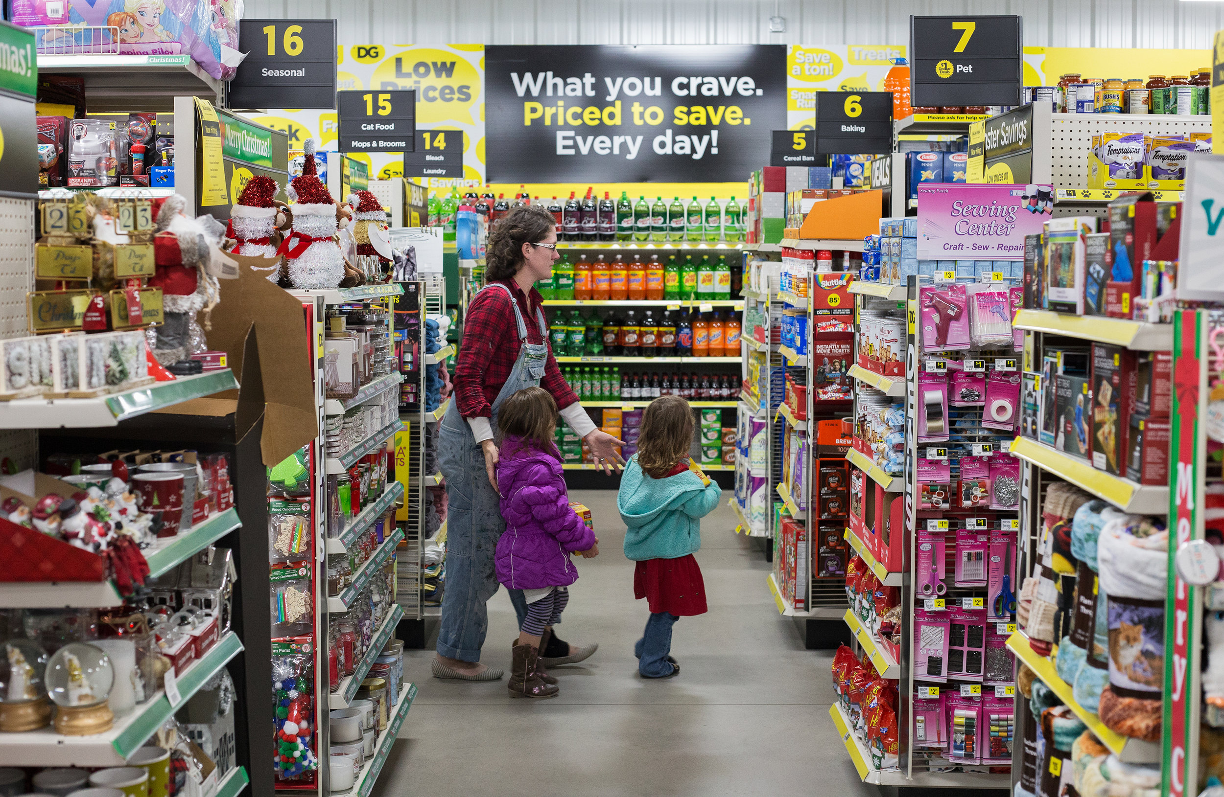 Local business owner Leah O'Neill, left, shops for cat food with her daughters Elizabeth and Emily O'Neill, 4, all of Evensville at Dollar General in Evensville, Tenn. Thursday, Nov. 16 2017.