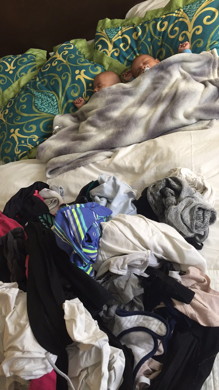 Folding laundry during nap time at the hotel