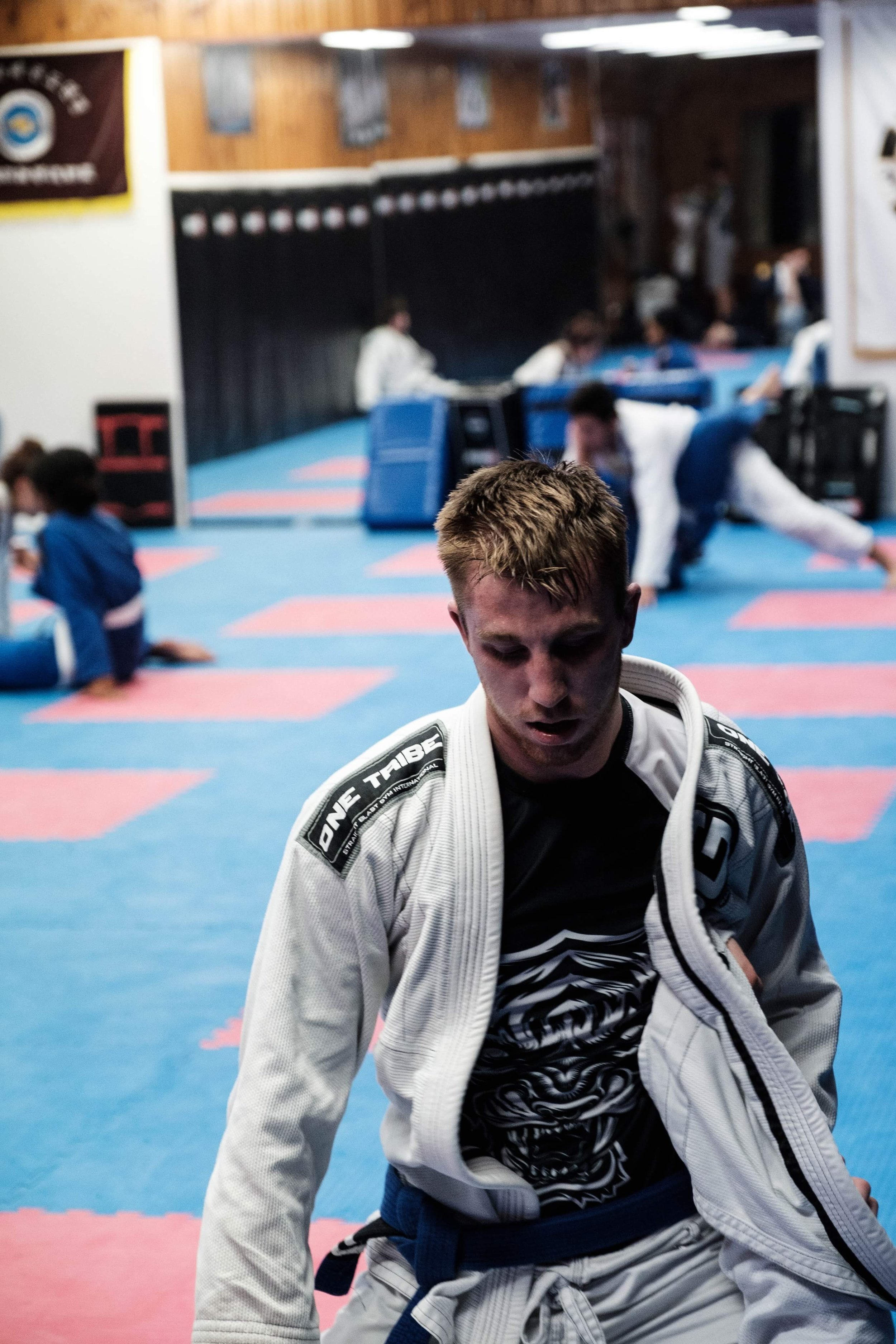 "Joel ""JDC"" Downey-Cave  A purple belt and young fighter has won many comps and competed in MMA. Has recently taken over the MMA class and developing a wonderful group of future MMA champions."