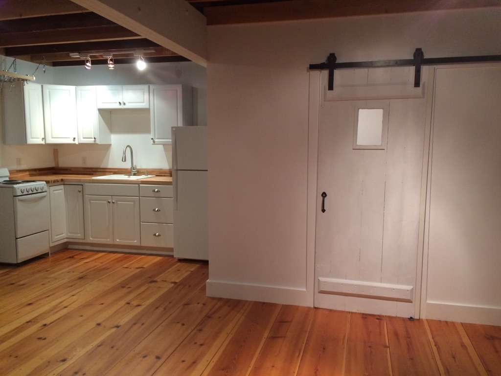 Sliding doors are great space savers. This one allowed us to turn a compact space into a fully functional bath.