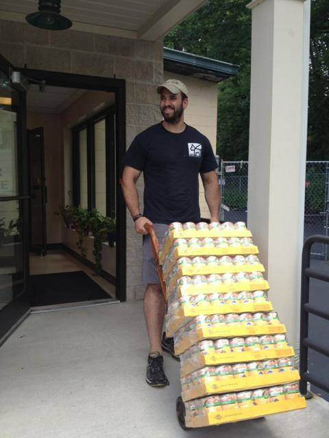 Daniel Reitman with Donations for Town of North Hempstead Animal Shelter.jpg