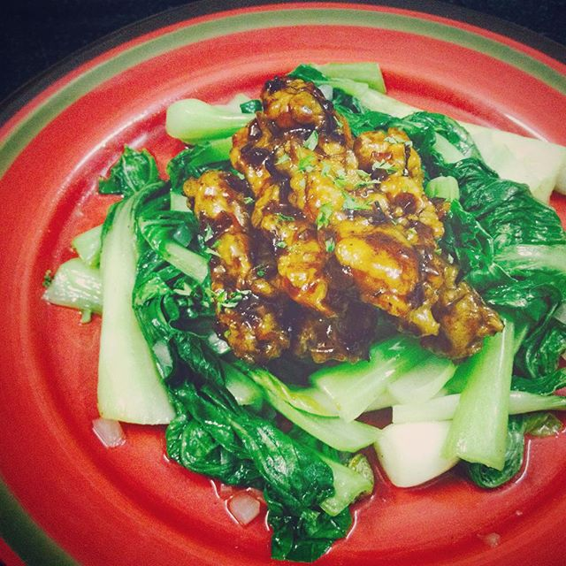 Stir fry tempeh on a bed of baby bok choy