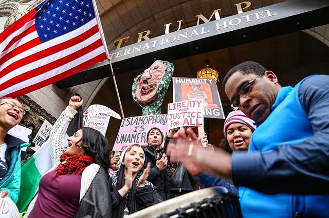 """On January 29th, 2017, attendees to a rally at Lafayette Park gathered on the steps of Trump international hotel to protest the recent executive order signed by President Trump which bans the entry of citizens from 7 different countries, as well as any refugees into the United States. ...""""Love not hate, that's what makes America great""""... sang the protesters to the rhythm of a djembe brought by one of the attendees. After close to 30 minutes the police moved in front of the protesters and reinstated the barricades that were previously in place at the front of the hotel. No arrests took place.  #Trump #DC #WashingtonDC #MAGA #politics #OnAssignment #Canon #NotIphone #ExecutiveOrder #LoveTrumpsHate #news #photojournalism #protest #NotASwamp #DCLiving #Weekend #ACLU #immigrant #NoMuslimBan #diversity #America #music #djembe #refugee"""