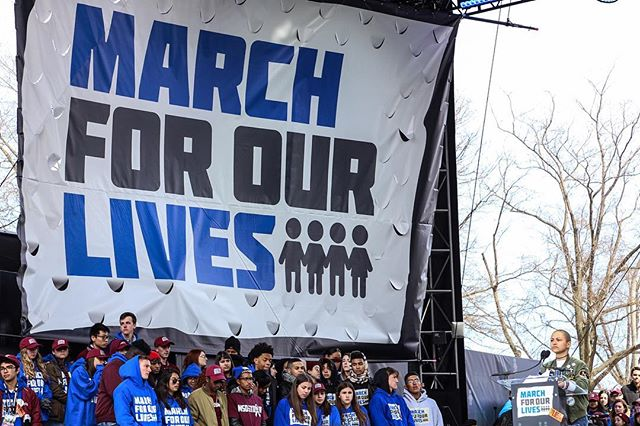 """On March 24th, 2018 Stoneman Douglas high school student Emma Gonzales speaks to a crowd gathered on Pennsylvania Ave. during the March for Our Lives.  Emma was joined on the side by her fellow schoolmates during her speech. After naming the school shooting victims she went silent for several minutes and resumed """"Since the time that I came out here, it has been 6 minutes and 20 seconds. The shooter has ceased shooting, and will soon abandon his rifle, blend in with the students as they escape, and walk free for an hour before arrest. Fight for your lives before it's someone else's job."""" #OnAssignment #breakingnews #breaking #reportagespotlight #WashingtonDC #protest #Canon #notiphone #Washington #photojournalism #politics #politica #protesta #GunControl #stonemandouglas #EndGunViolence #NotOneMore #activism #Parkland #MarchForOurLives #emmagonzalez @marchforourlives"""