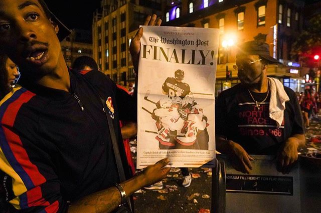 """On June 8th, 2018, during the whee hours of the morning, a newspaper seller advertises the latest cover of the @washingtonpost announcing the Stanley cup win by the Capitals against the @vegasgoldenknights . """"Three dollars, Three dollars, get a piece of history, fresh off the press"""". #AllCaps #capitals #champions  #WashingtonDC #igdc #BreakingNews #hockey #gamefive #NHL #photojournalism #fans #fan #StanleyCup #GoldenKnights #night #bythings #Caps #goals #champions #sports #streetphotography #Caps #sports #RockTheRed @espn @espndeportes @nhl @waltoncaps @rmnb_blog  @andreburakovsky @fromrussiawithglove @aleksandrovechkinofficial @hockeylife_style @wusa9 @houseofhighlights @aimeejcraw @nbcsports @nbcswashington @sportsillustrated @sportscenter @thehockeynews @gatorade @capitalone @kettlericeplex @geico @monsportsnet @monumentalsport @nova_caps"""